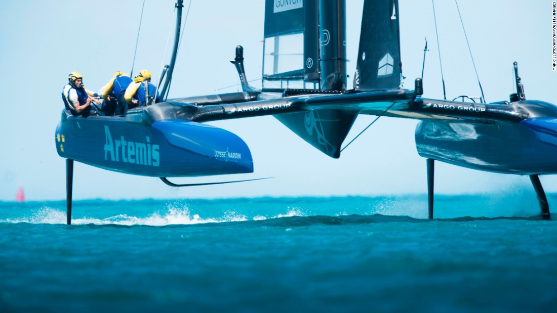 Artemis Racing skippered by Nathan Outteridge skim across the waters of Great Sound, Bermuda, during race 14 of the 2017 America's Cup qualifiers.