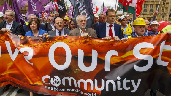 Corbyn (center) marches with demonstrating steelworkers in London in 2016.