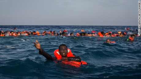Refugees and migrants are seen swimming and yelling for assistance from a Migrant Offshore Aid Station vessel after a wooden boat bound for Italy carrying more than 500 people capsized last month.