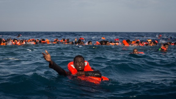 LAMPEDUSA, ITALY - MAY 24:  Refugees and migrants are seen swimming and yelling for assistance from crew members from the Migrant Offshore Aid Station (MOAS)