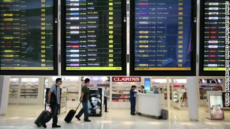 British reporter Tony Cheng was arrested at a Bangkok airport for carrying body armor and a gas mask.