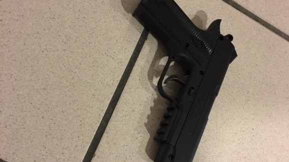 """This is the gun the suspect was carrying and threatening officers with,"" the Orlando Police Department said. The weapon later turned out to be fake, police said."