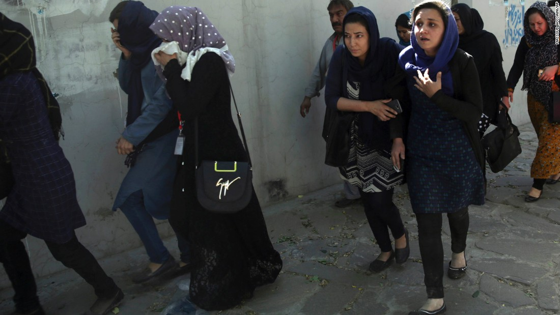 "Office workers leave the site of the suicide attack. German Foreign Minister Sigmar Gabriel said the attack was ""aimed at civilians and those who are in Afghanistan to work with the people there for a better future of the country."""