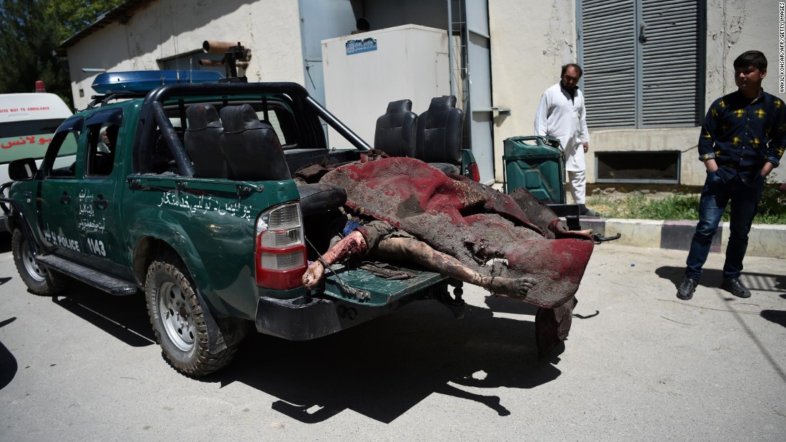 Victims' bodies are placed in the back of a police truck at a hospital in Kabul.