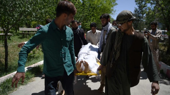 Volunteers carry the body of a victim to the Wazir Akbar Khan Hospital in Kabul.