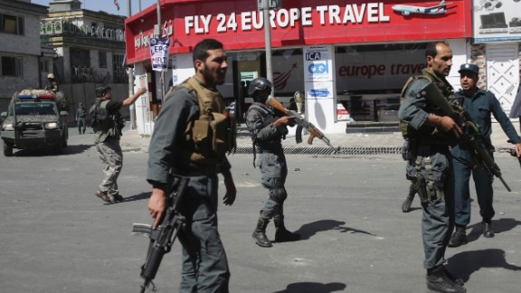 Security forces gather near the site of the attack.