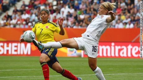 Lori Lindsey is challenged by Catalina Usme of Colombia during the 2011 FIFA Women's World Cup