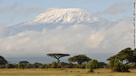 Fresh snow covered Mount Kilimanjaro seen at sunrise from Ambuseli game reserve in Kenya