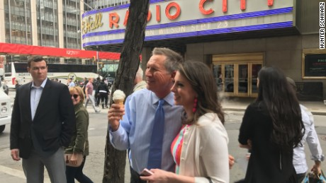Ohio Gov. John Kasich poses for a photo after grabbing an ice cream cone outside Radio City Music Hall.