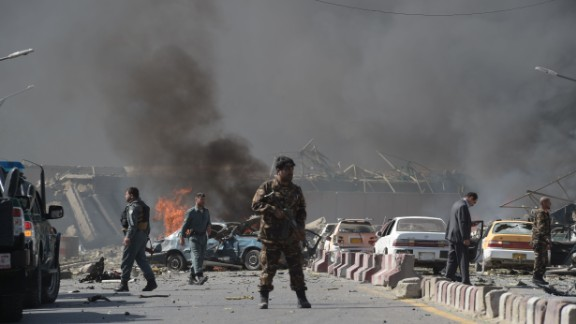 An Afghan security force member stands at the site of a car bomb attack in Kabul on May 31, 2017. At least 40 people were killed or wounded on May 31 as a massive blast ripped through Kabul's diplomatic quarter, shattering the morning rush hour and bringing carnage to the streets of the Afghan capital. / AFP PHOTO / SHAH MARAI        (Photo credit should read SHAH MARAI/AFP/Getty Images)