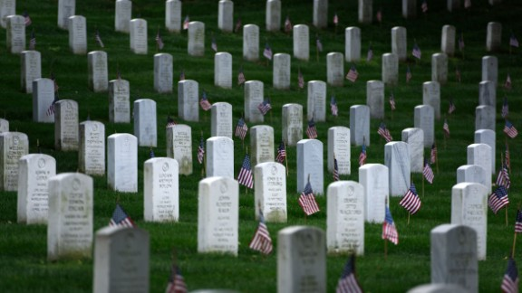 American flags are placed at graves at Arlington National Cemetery on May 25, 2017 in Arlington, Virginia in preparation for Memorial Day. / AFP PHOTO / Brendan SMIALOWSKI        (Photo credit should read BRENDAN SMIALOWSKI/AFP/Getty Images)