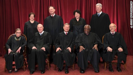 Nine at last, Supreme Court justices sit for class photo ahead of busy month