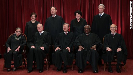 The justices of the Supreme Court gather for an official group portrait to include new Associate Justice Neil Gorsuch, top row, far right, on June 1, 2017 at the Supreme Court Building in Washington. Seated, from left are Associate Justice Ruth Bader Ginsburg, Associate Justice Anthony Kennedy, Chief Justice John Roberts, Associate Justice Clarence Thomas, and Associate Justice Stephen Breyer. Standing, from left: Associate Justice Elena Kagan, Associate Justice Samuel Alito Jr., Associate Justice Sonia Sotomayor and Gorsuch.