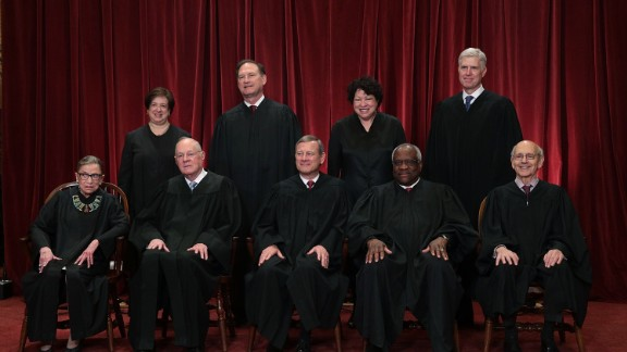 Front row from left, U.S. Supreme Court Associate Justice Ruth Bader Ginsburg, Associate Justice Anthony M. Kennedy, Chief Justice John G. Roberts, Associate Justice Clarence Thomas, and Associate Justice Stephen Breyer, back row from left, Associate Justice Elena Kagan, Associate Justice Samuel Alito Jr., Associate Justice Sonia Sotomayor, and Associate Justice Neil Gorsuch pose for a group portrait in the East Conference Room of the Supreme Court June 1, 2017 in Washington, DC.