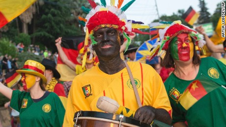 People in blackface and carry bananas while marching in a government-backed parade in Sochi, Russia on May 27. The city will host one of Cameroon's matches at the Confederations Cup soccer tournament