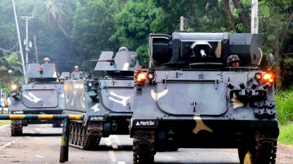 Philippines government armored vehicles enter Marawi on May 31.