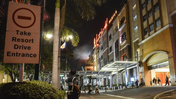 A police officer stands guard outside the resort.