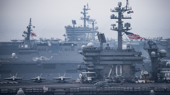 The US aircraft carriers USS Carl Vinson, foreground, and USS Ronald Reagan, back, steam with the Japanese helicopter carrier JS Hyuga, center, in the Sea of Japan/East Sea during an exercise on June 1, 2017.