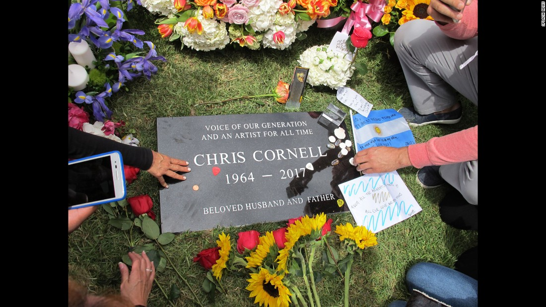 "Fans of the late rock star Chris Cornell pay tribute to the singer at his gravesite in Los Angeles on Friday, May 26. Cornell, the lead singer of Soundgarden and Audioslave, <a href=""http://www.cnn.com/2017/05/18/entertainment/chris-cornell-dead/index.html"" target=""_blank"">hanged himself</a> May 18, according to a statement from the medical examiner's office in Wayne County, Michigan. He was 52."