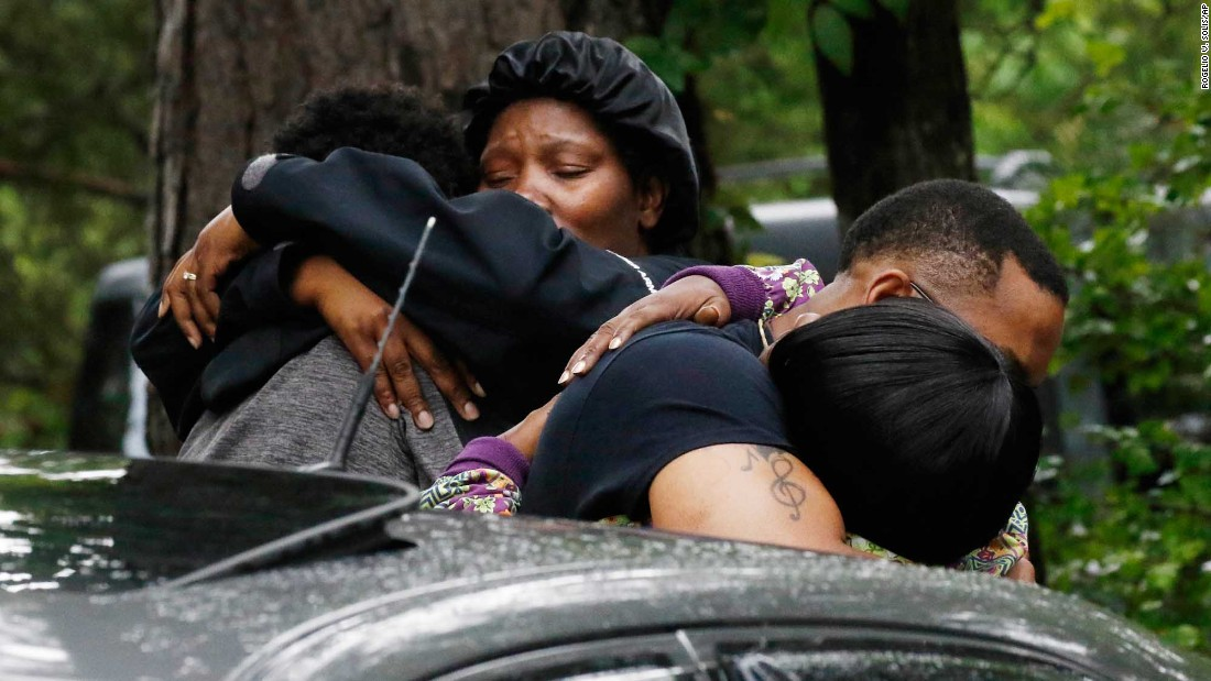 "People embrace Sunday, May 28, outside a house where several people were killed during <a href=""http://www.cnn.com/2017/05/28/us/mississippi-mass-shooting/index.html"" target=""_blank"">a shooting rampage</a> in Lincoln County, Mississippi. A sheriff's deputy and seven other people were killed, authorities said. Willie Godbolt, 35, has been charged with one count of capital murder and seven counts of first-degree murder."