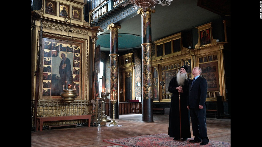 Russian President Vladimir Putin and Metropolitan Korniliy, the head of the Russian Orthodox Old-Rite Church, visit the church's Intercession cathedral in Moscow on Wednesday, May 31.