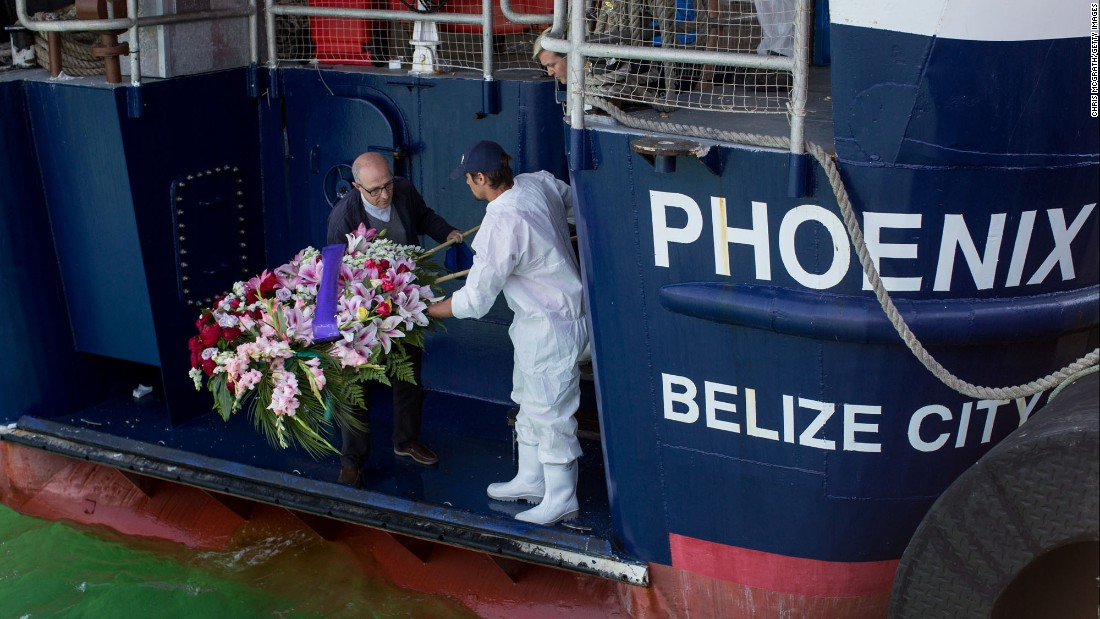"A priest, left, and a crew member from the rescue group MOAS lay a wreath for migrants who drowned Wednesday, May 24, when <a href=""http://www.cnn.com/interactive/2017/05/world/migrant-rescue-cnnphotos/index.html"" target=""_blank"">their boat capsized off the coast of Italy.</a> So far this year, about 50,000 people have risked their lives to reach Europe by sea, <a href=""http://www.unhcr.org/en-us/europe-emergency.html"" target=""_blank"">according to the UN Refugee Agency.</a> Nearly 1,750 are estimated to be dead or missing. <a href=""http://www.cnn.com/2017/05/25/world/gallery/week-in-photos-0526/index.html"" target=""_blank"">See last week in 28 photos</a>"