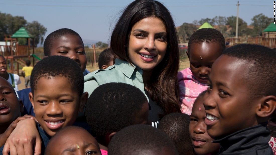 On May 7, 2017 in South Africa, UNICEF Goodwill Ambassador Priyanka Chopra smiles amid a group of children, at the Isibindi Safe Park in Soweto Township, in the city of Johannesburg.