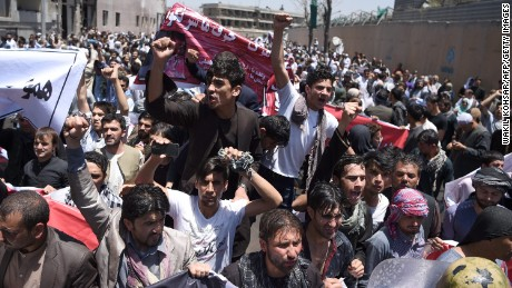 Afghan protesters shout anti-government slogans during a protest against the government following a catastrophic truck bomb attack near Zanbaq Square in Kabul on June 2, 2017. Afghan police June 2 fired live rounds to disperse hundreds of stone-throwing protesters seeking to march on the presidential palace to demand the government's resignation following a catastrophic truck bombing that killed 90 people and wounded hundreds. / AFP PHOTO / WAKIL KOHSAR        (Photo credit should read WAKIL KOHSAR/AFP/Getty Images)