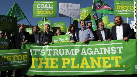 Protests erupted over President Trump's decision to pull the world's second biggest emitter of greenhouse gases out of the Paris Agreement.