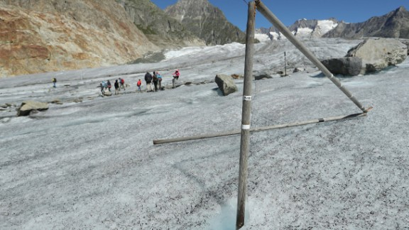 A wooden pole that had been driven into the ice the year before now stands exposed as the Aletsch glacier melts and sinks at a rate of about 10-13 meters per year near Bettmeralp, Switzerland.