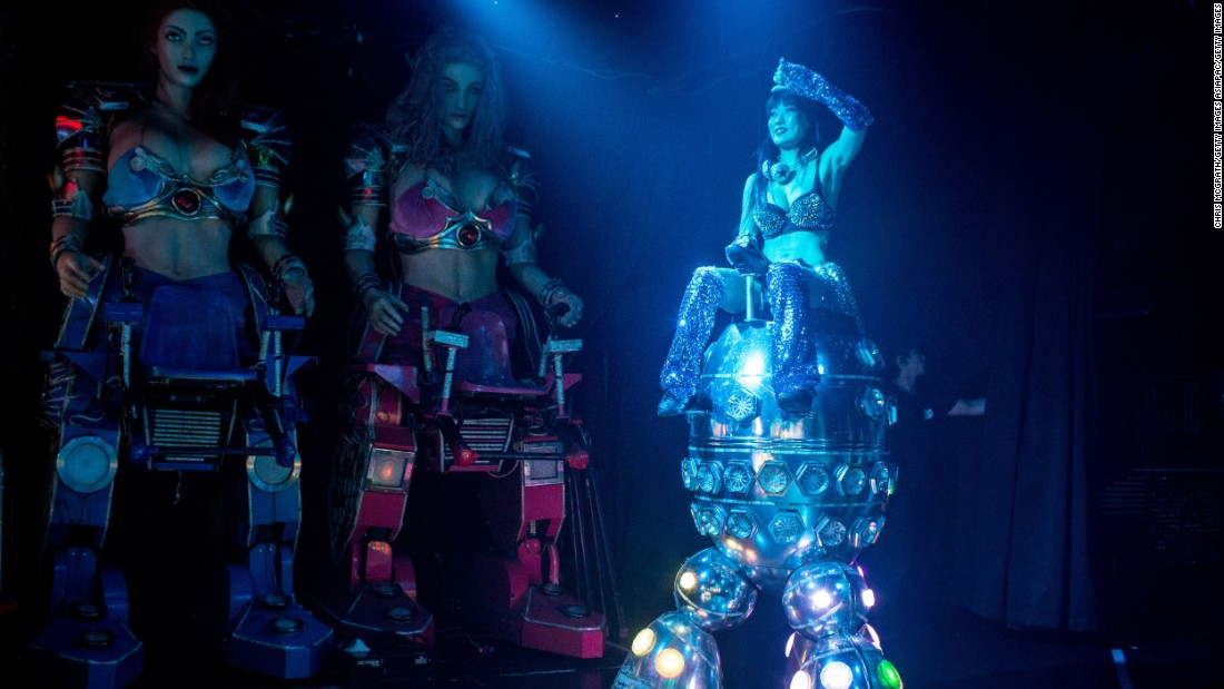 "But the robots at Tokyo's famous ""Robot Restaurant"" aren't quite what they seem. Here, dancers in robot suits stage mock battles. Performances have included fembots with Thor hammers, dinosaurs battling robots and a giant neon tank.<br />"