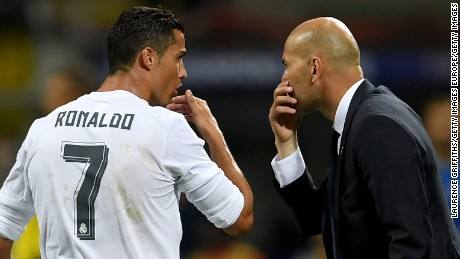 MILAN, ITALY - MAY 28: Cristiano Ronaldo of Real Madrid  speaks to head coach Zinedine Zidane during the UEFA Champions League Final match between Real Madrid and Club Atletico de Madrid at Stadio Giuseppe Meazza on May 28, 2016 in Milan, Italy.  (Photo by Laurence Griffiths/Getty Images)