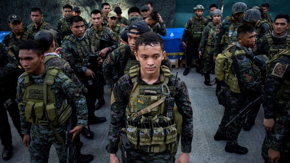 Soldiers stand in front of the Resorts World Hotel following an attack in Manila on June 2, 2017.