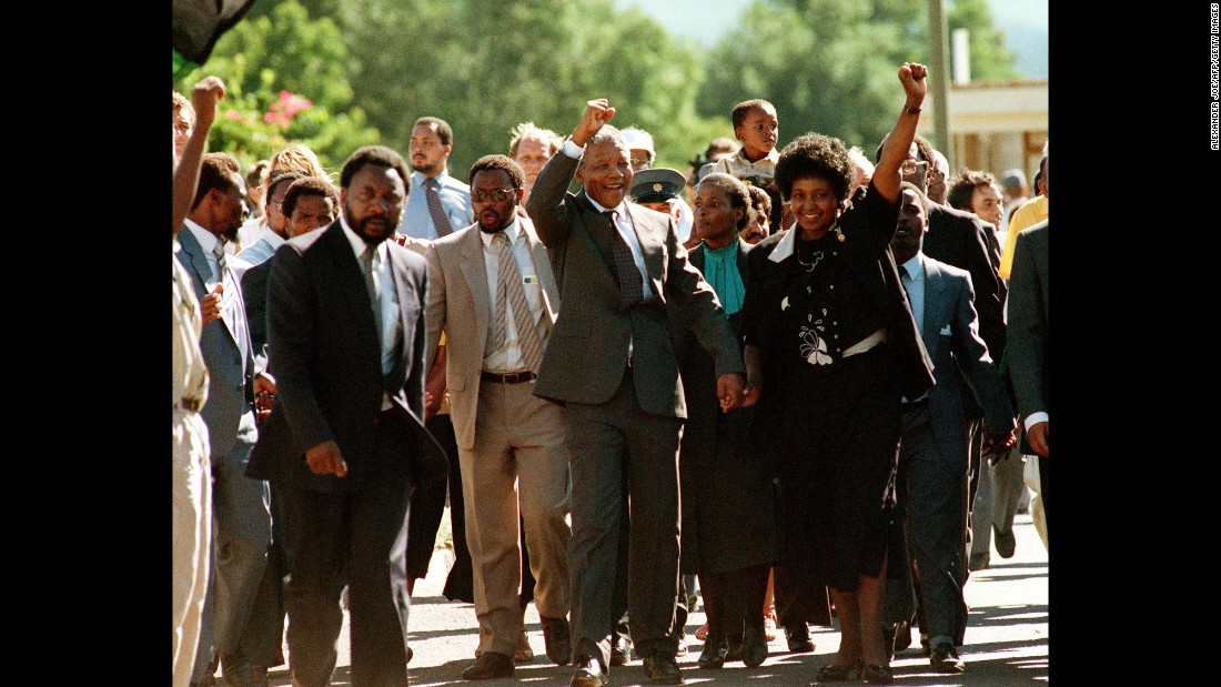 "After spending <a href=""http://www.cnn.com/2016/02/25/africa/south-africa-jail-mandela/index.html"">27 years in prison</a>, Nelson Mandela and his then-wife, Winnie, raise their fists in celebration of Mandela's release from custody on February 11, 1990. Mandela became President of South Africa after his release and played a pivotal role in leading his country out of apartheid's decades of racial segregation. <a href=""http://www.cnn.com/2013/12/05/world/africa/nelson-mandela/index.html"">He died at age 95</a> on December 5, 2013."