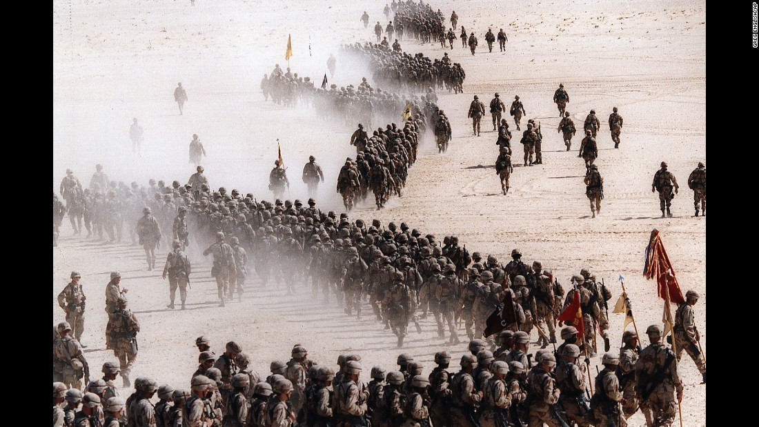 "Saddam Hussein's decision to invade neighboring Kuwait led the United States and its allies to intervene. Here, US troops fan out across the Saudi desert on November 4, 1990. The<a href=""http://www.cnn.com/2016/01/19/middleeast/operation-desert-storm-25-years-later/index.html""> Gulf War</a> lasted 42 days. Coalition attacks ended on February 28, 1991, after President George H.W. Bush declared a ceasefire.<br />"