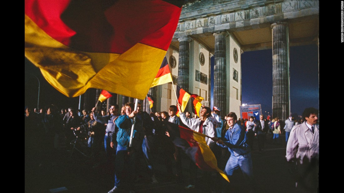 After decades of division after World War II, a treaty that brought together the German Democratic Republic and the Federal Republic to form a unified Germany was ratified on October 3, 1990. Here, Germans celebrate the news in front of Berlin's iconic Brandenburg Gate.
