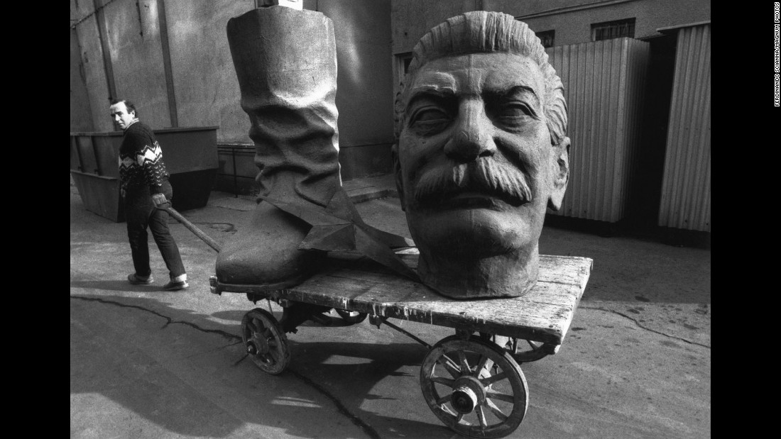 One by one, Eastern European countries cut their ties with Moscow in the early 1990s, leading to the fall of communism and the dissolution of the Soviet Union. In this 1990 photo from Hungary, a dismantled statue of Joseph Stalin is dragged through the streets of Budapest.