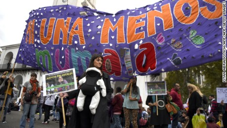 "Women demonstrate on April 11, 2017 at Plaza de Mayo square in Buenos Aires against gender violence and in solidarity with Argentina's latest femicide victim, 21-year-old Micaela Garcia, a ""Ni Una Menos"" (Not One Less) movement activist, whose body was found Saturday in a rural field in Gualeguay, Entre Rios province.  A feminicide occurs every 30 hours in Argentina. / AFP PHOTO / EITAN ABRAMOVICH        (Photo credit should read EITAN ABRAMOVICH/AFP/Getty Images)"
