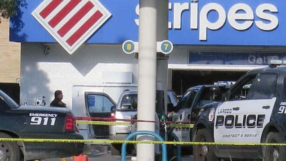 Laredo Police investigators survey the scene of a fatal shootout.