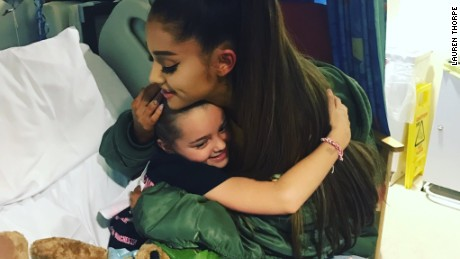 Pop star Ariana Grande visited a fan at the hospital who was injured in last month's terror attack at her Manchester concert.