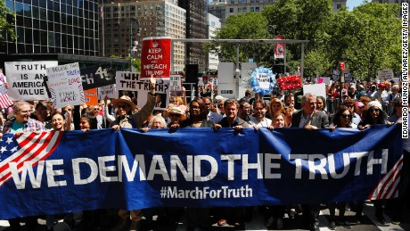 "Demonstrators march as they take part in an anti-Trump ""March for Truth"" rally on June 3, 2017 in New York City."