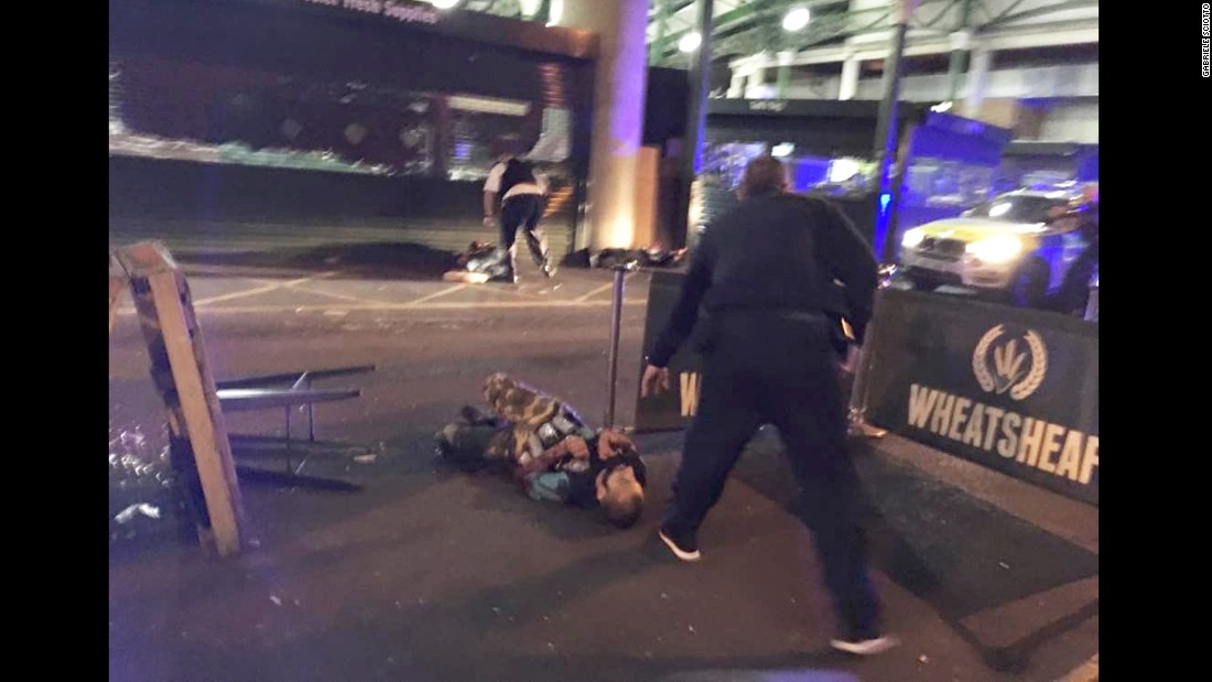 "This image, from London's Borough Market, shows two of the attackers after they were shot by London police. The attackers drove a white van into pedestrians on London Bridge, leaving bodies lying in the roadway, a witness to the incident <a href=""http://us.cnn.com/2017/06/03/europe/london-bridge-incident/index.html"" target=""_blank"">told CNN</a>."