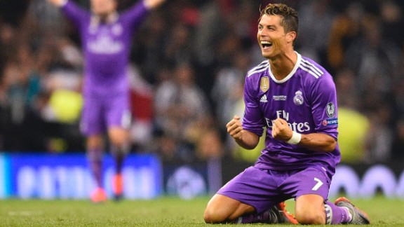 Real Madrid's Portuguese striker Cristiano Ronaldo falls to his knees as he celebrates their victory on the final whistle of the UEFA Champions League final football match between Juventus and Real Madrid at The Principality Stadium in Cardiff, south Wales, on June 3, 2017. Real Madrid beat Juventus 4-1 to win Champions League. / AFP PHOTO / Glyn KIRK        (Photo credit should read GLYN KIRK/AFP/Getty Images)