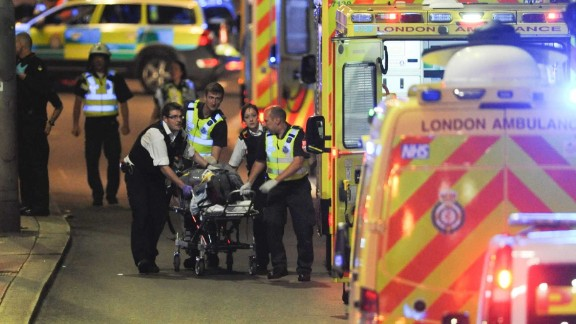 Police officers and members of the emergency services attend to a person injured in an apparent terror attack on London Bridge in central London on June 3, 2017.Armed police fired shots after reports of stabbings and a van hitting pedestrians on London Bridge on Saturday in an incident reminiscent of a terror attack in March just days ahead of a general election. / AFP PHOTO / DANIEL SORABJI        (Photo credit should read DANIEL SORABJI/AFP/Getty Images)