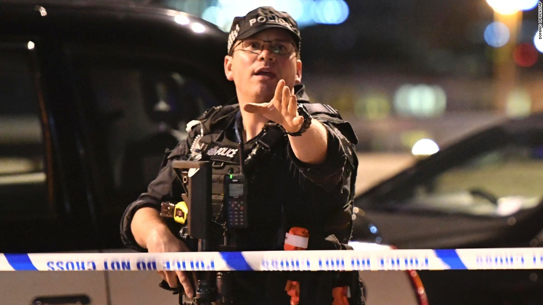 An armed Police officer gestures after the attack in central London.