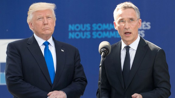 NATO Secretary General Jens Stoltenberg (R), flanked by US President Donald Trump, speaks during the unveiling ceremony of the new headquarters of NATO (North Atlantic Treaty Organization) on May 25, 2017 in Brussels during a NATO Summit.