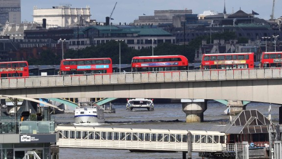 "Abandoned buses line London Bridge as the scene remains under investigation following the attack. Metropolitan Police Assistant Commissioner Mark Rowley said in a statement Sunday that a white van struck pedestrians on London Bridge.  Attackers then left the vehicle and ""a number of people were stabbed, including an on-duty British Transport Police officer who was responding to the incident at London Bridge,"" said Rowley. The officer received serious but not life-threatening injuries."