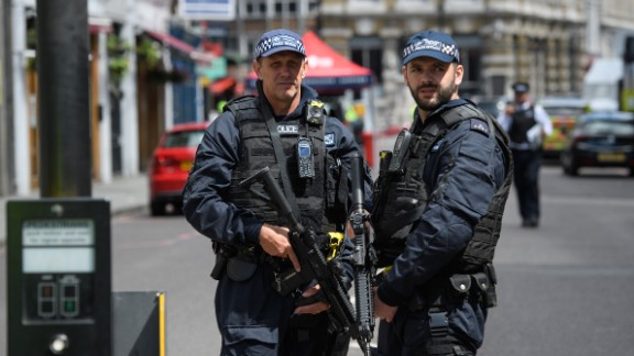 LONDON, ENGLAND - JUNE 04:  Armed police officers stand guard at the perimeter cordon, following last night