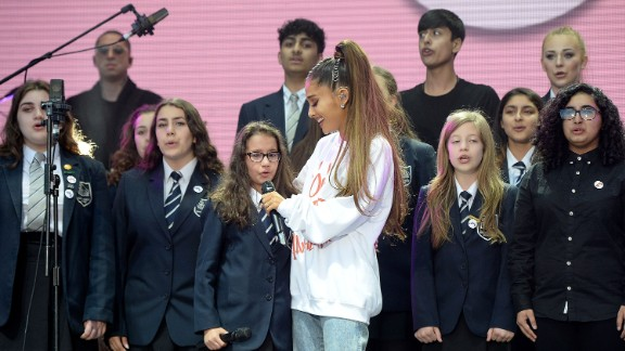 Ariana Grande performs with The Children