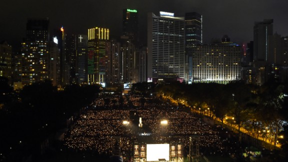 Participants hold candles at Hong Kong's Victoria Park on June 4, 2017, during a candlelight vigil to mark the 28th anniversary of the 1989 Tiananmen crackdown in Beijing.